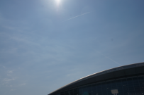Sun shines over the roof of Hall 3.